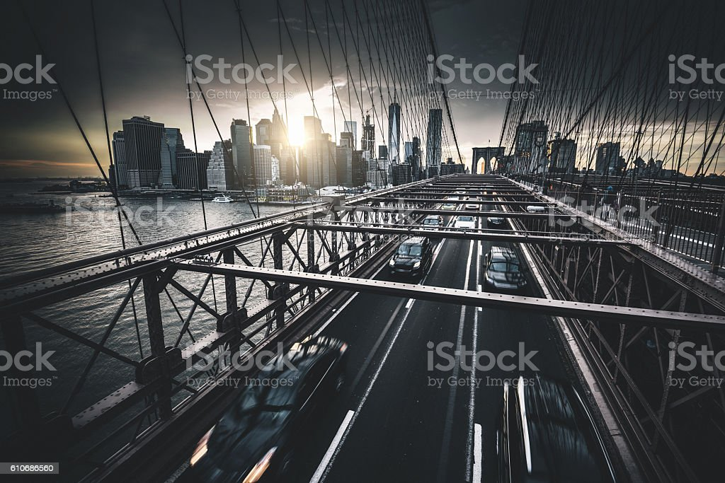 taxi running fast on nyc brooklyn bridge stock photo