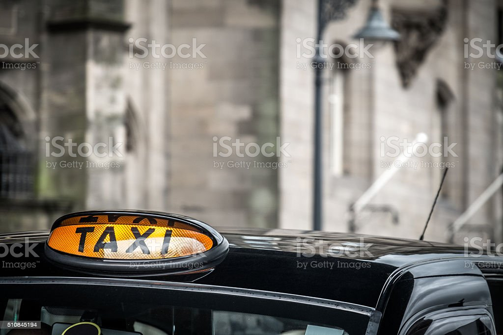 Taxi sign, Edinburgh, Scotland stock photo