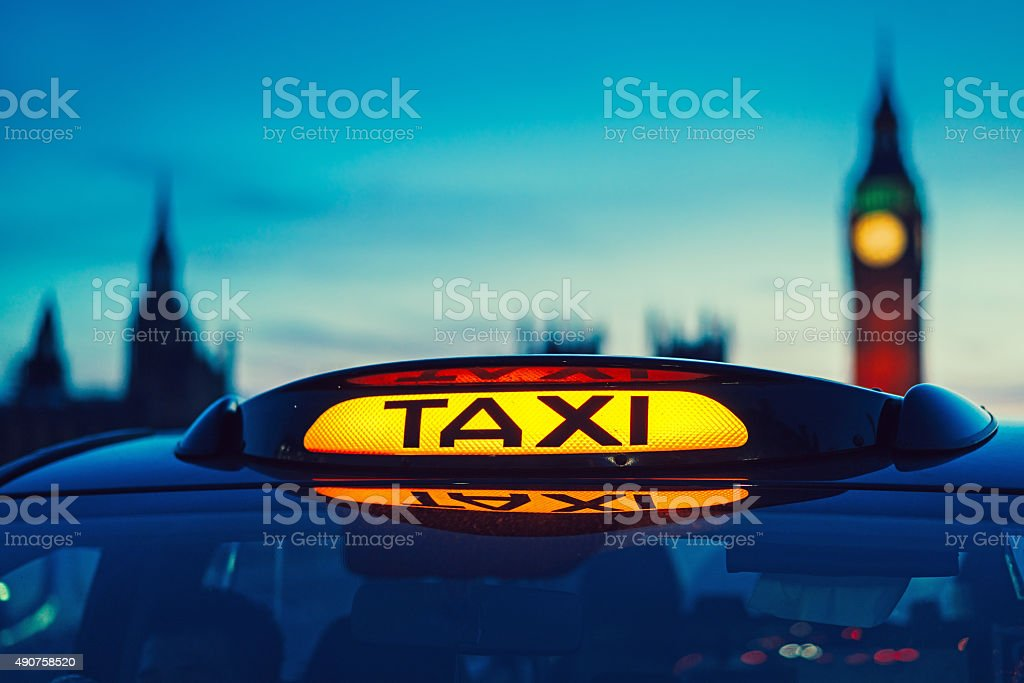 Taxi sign in London stock photo