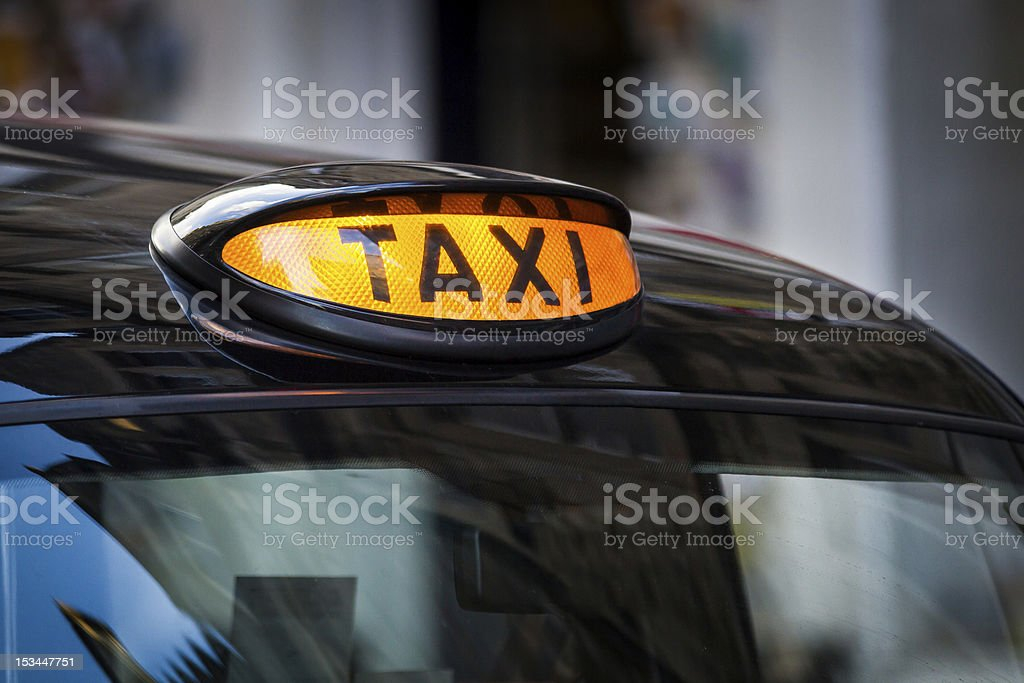 Taxi sign in UK stock photo