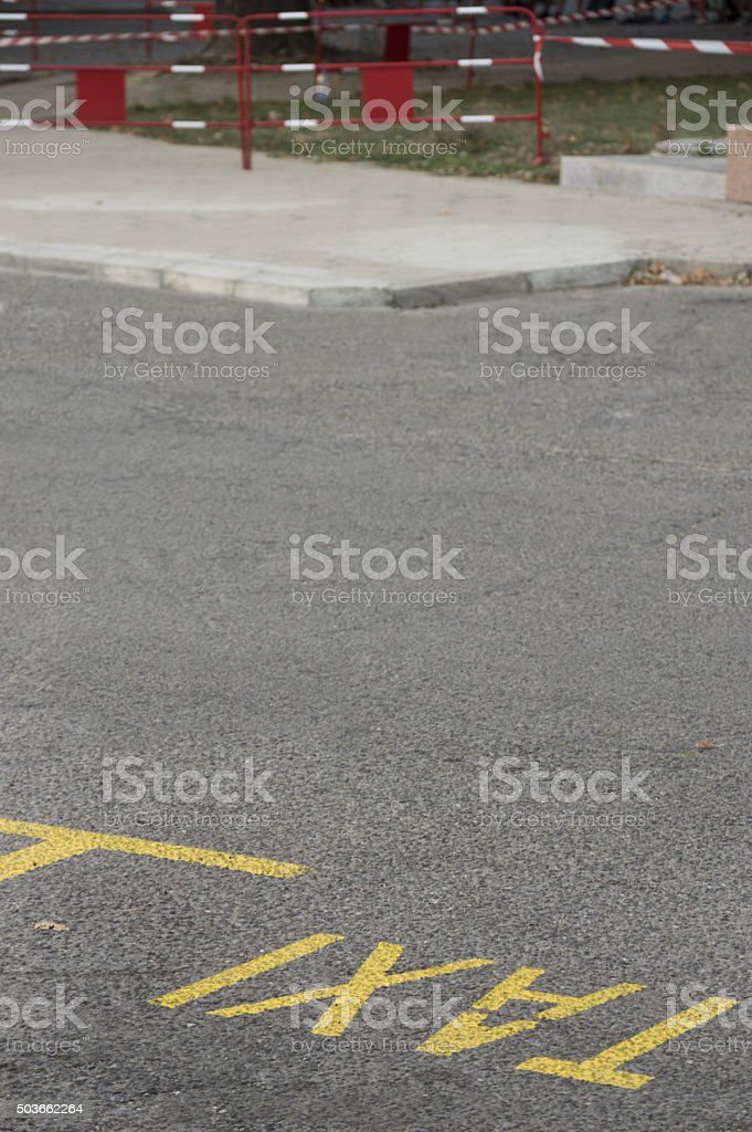 Taxi sign on the road stock photo