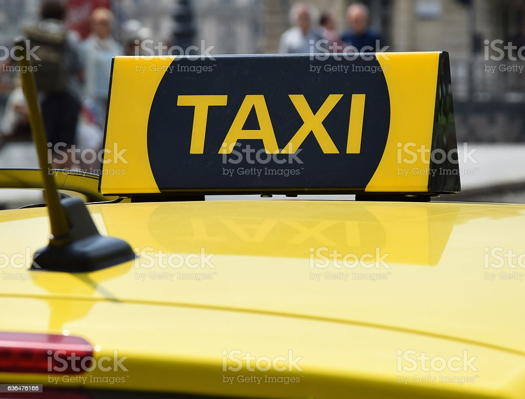 Taxi sign on the top of a car stock photo
