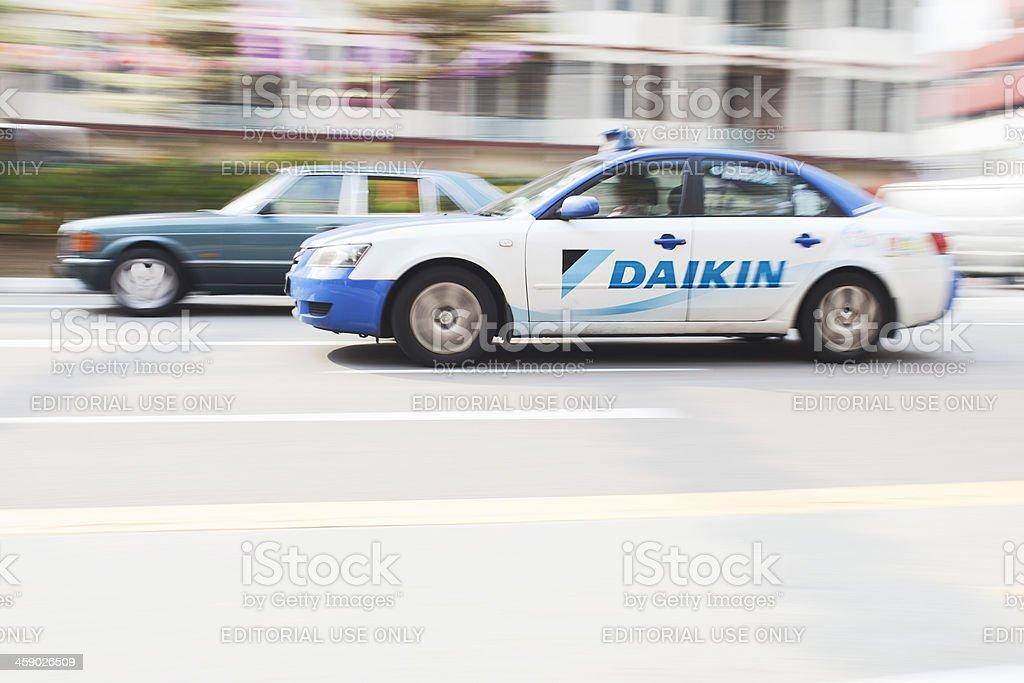 Taxi speeding through a china town. stock photo