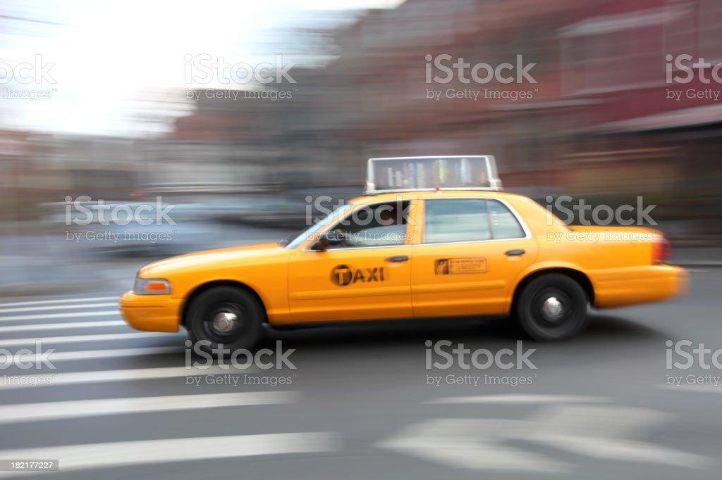 Taxi Speeding Through Intersection royalty-free stock photo