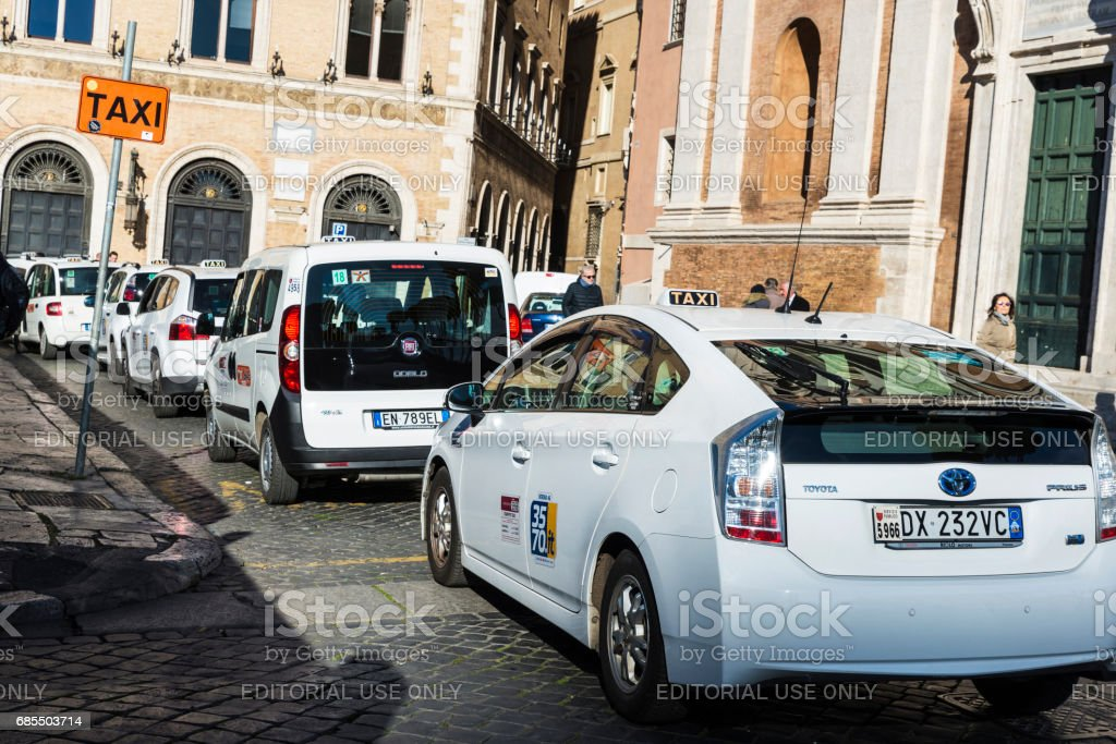 Taxi stand with many white taxis in Rome, Italy stock photo