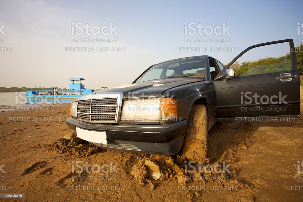 Taxi stucked in the mud, Mali stock photo
