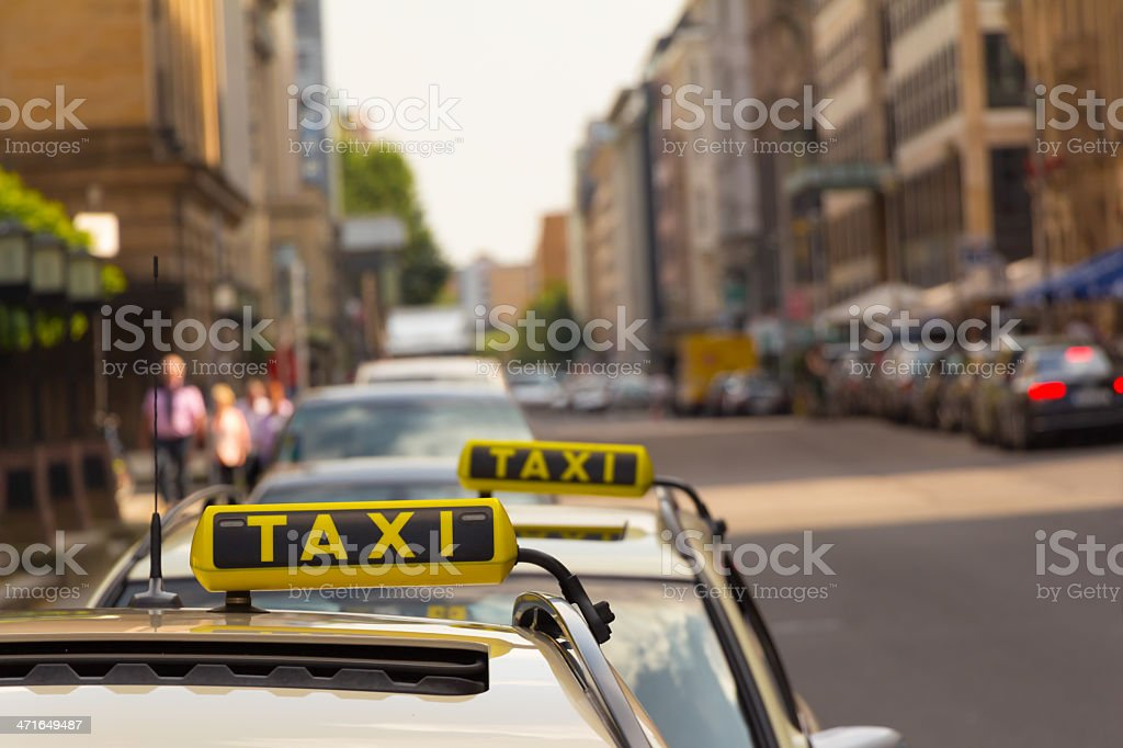 Taxi waiting in front of another one royalty-free stock photo