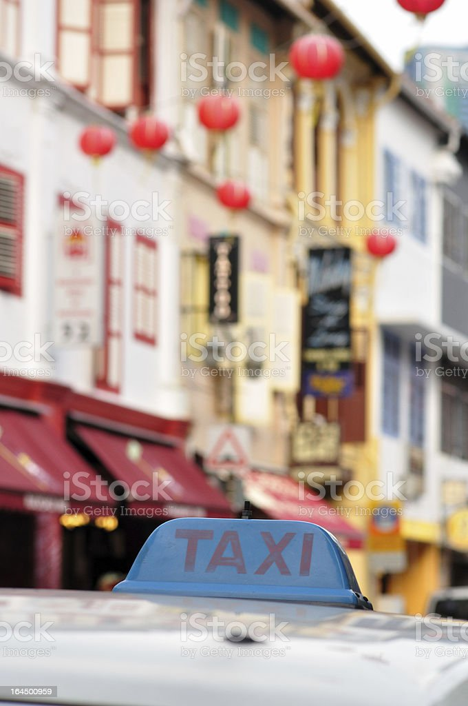taxi with chinatown blurred out in background royalty-free stock photo