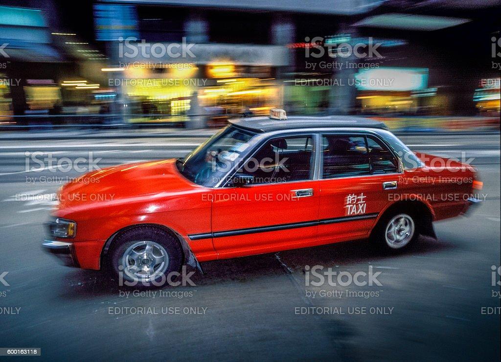 taxi with passengers passing Hong Kong railroad station stock photo