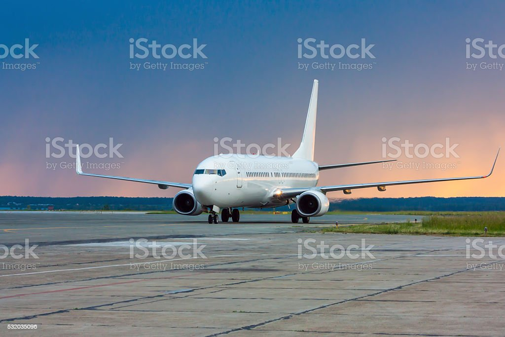 Taxiing aircraft early in the morning on the main taxiway stock photo