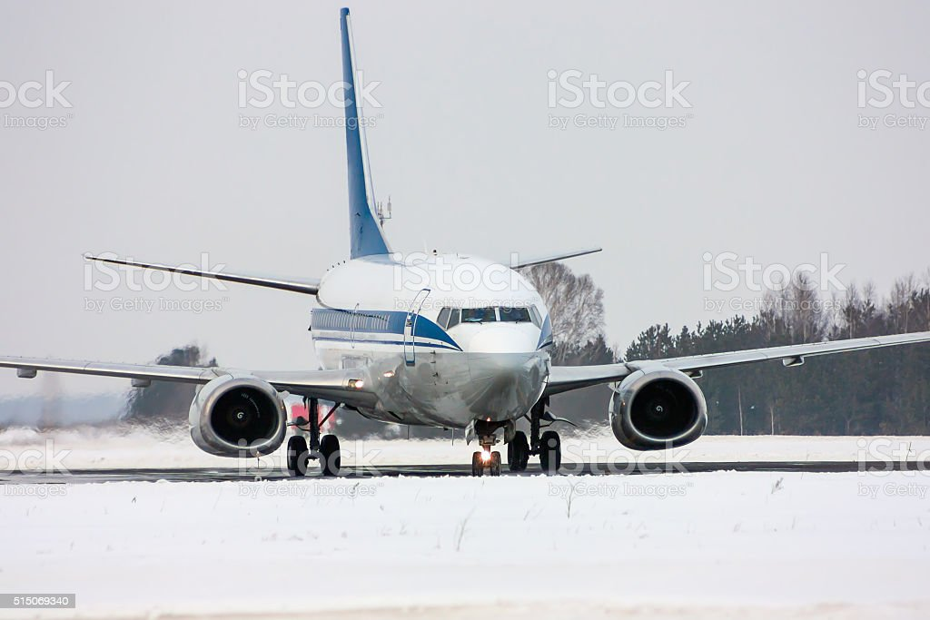 Taxiing aircraft in a cold winter airport royalty-free stock photo