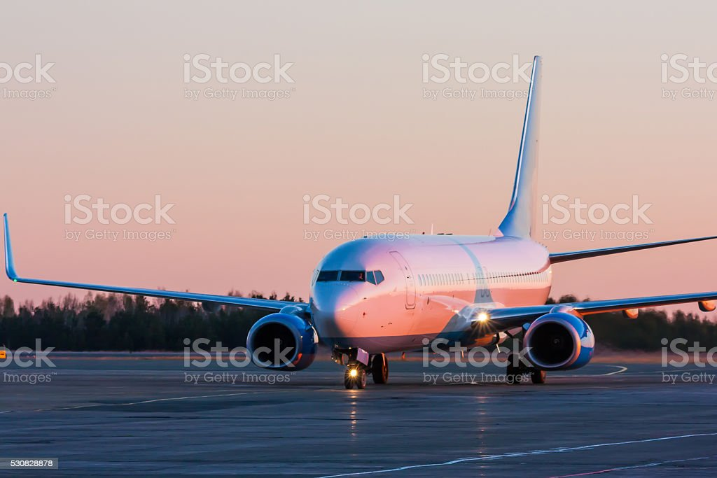 Taxiing aircraft in the morning crimson royalty-free stock photo