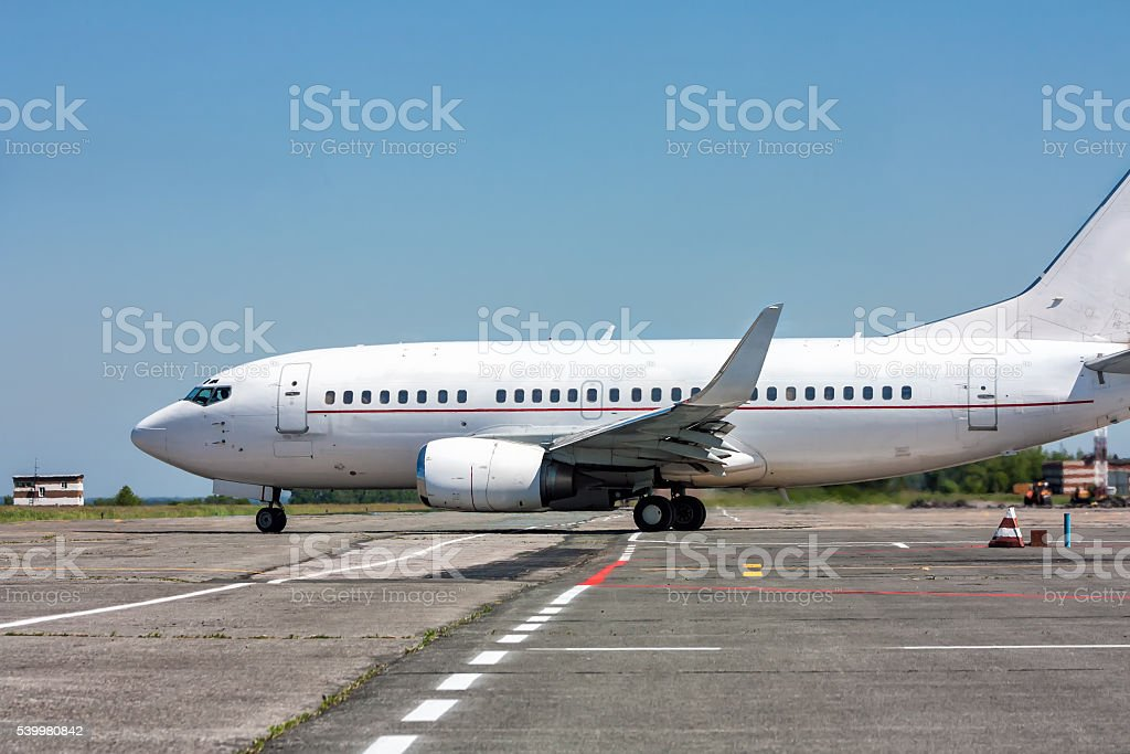 Taxiing aircraft on the airport apron royalty-free stock photo