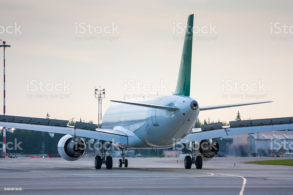 Taxiing aircraft with extended spoilers royalty-free stock photo