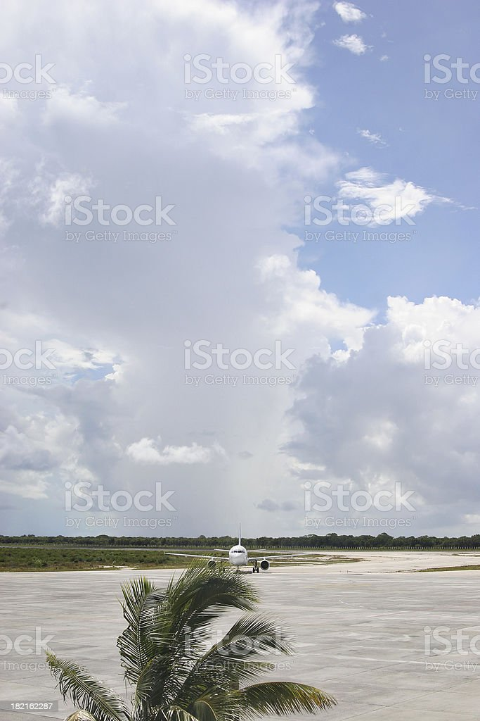 Taxiing Aircraft with giant cloud overhead royalty-free stock photo