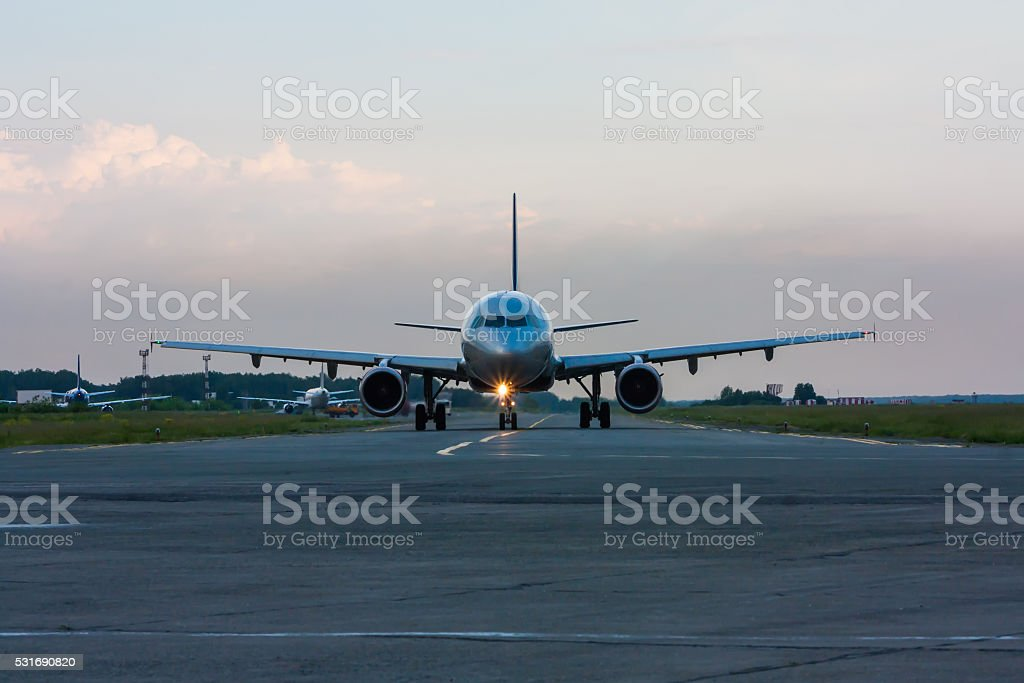 Taxiing airplane early in the morning on the main taxiway royalty-free stock photo