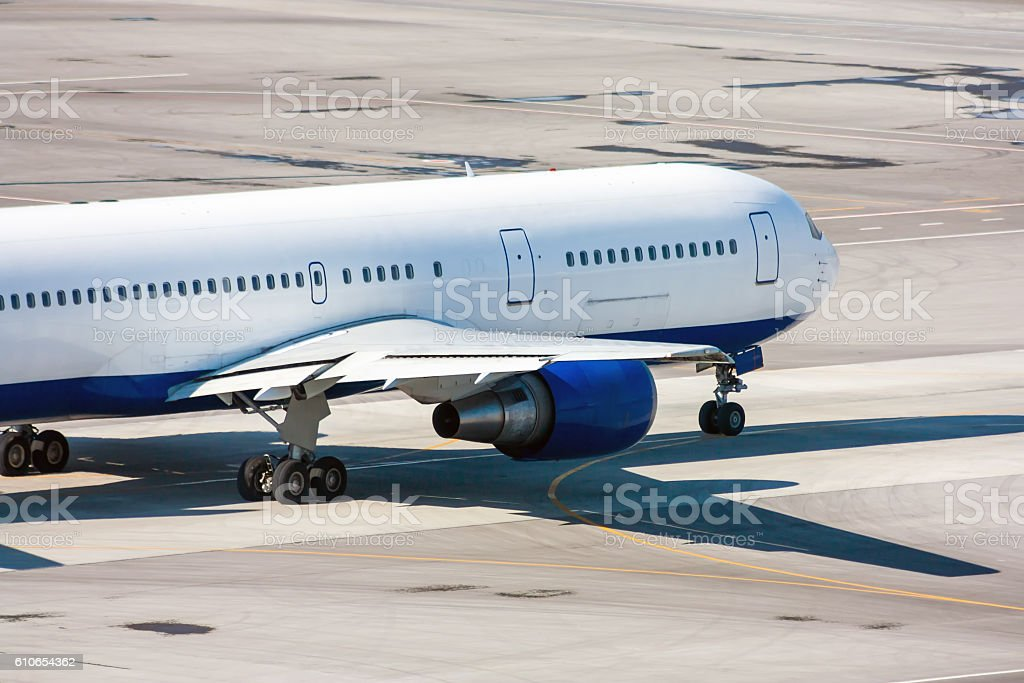 Taxiing airplane on the airport apron royalty-free stock photo