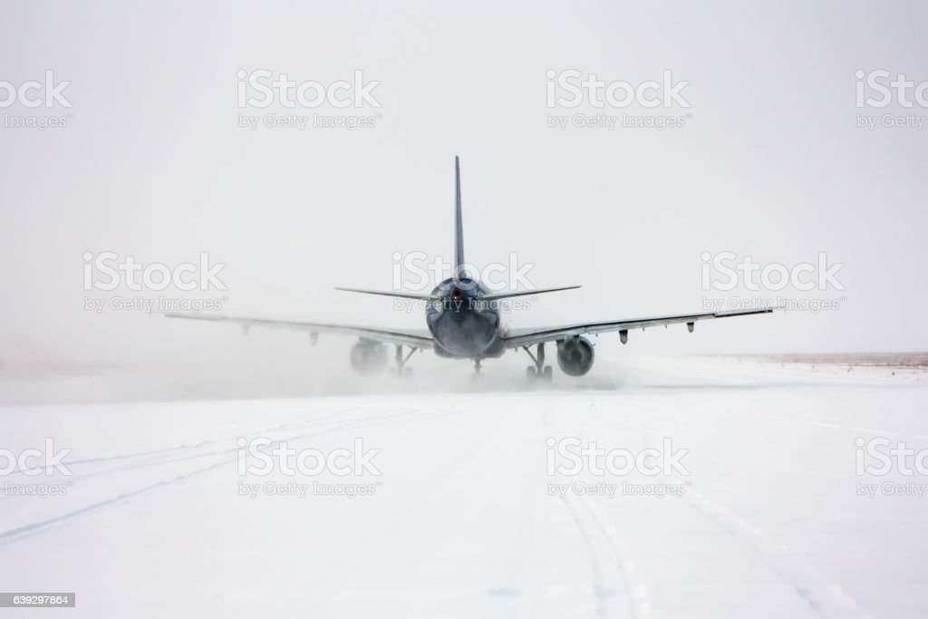 Taxiing passenger aircraft in a snow blizzard stock photo