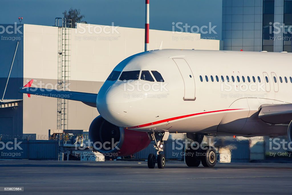 Taxiing passenger aircraft on the airport apron royalty-free stock photo