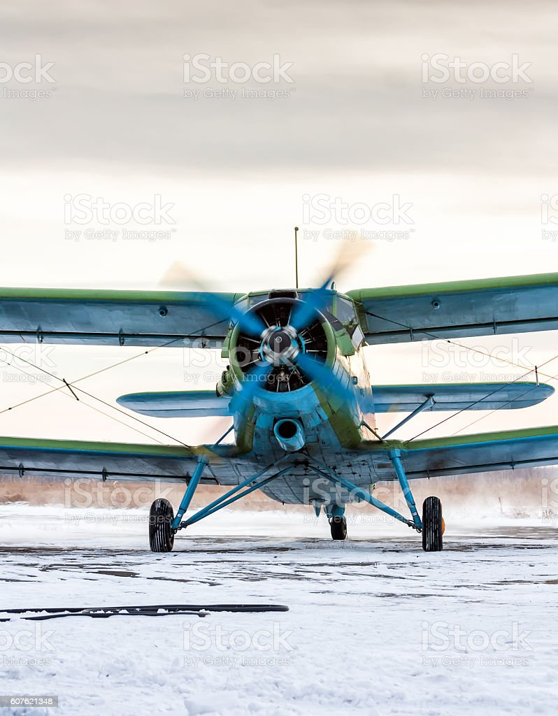 Taxiing single-engine biplane in a cold winter day royalty-free stock photo