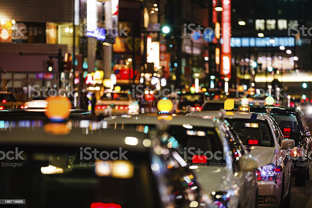 Taxis at night in Tokyo stock photo