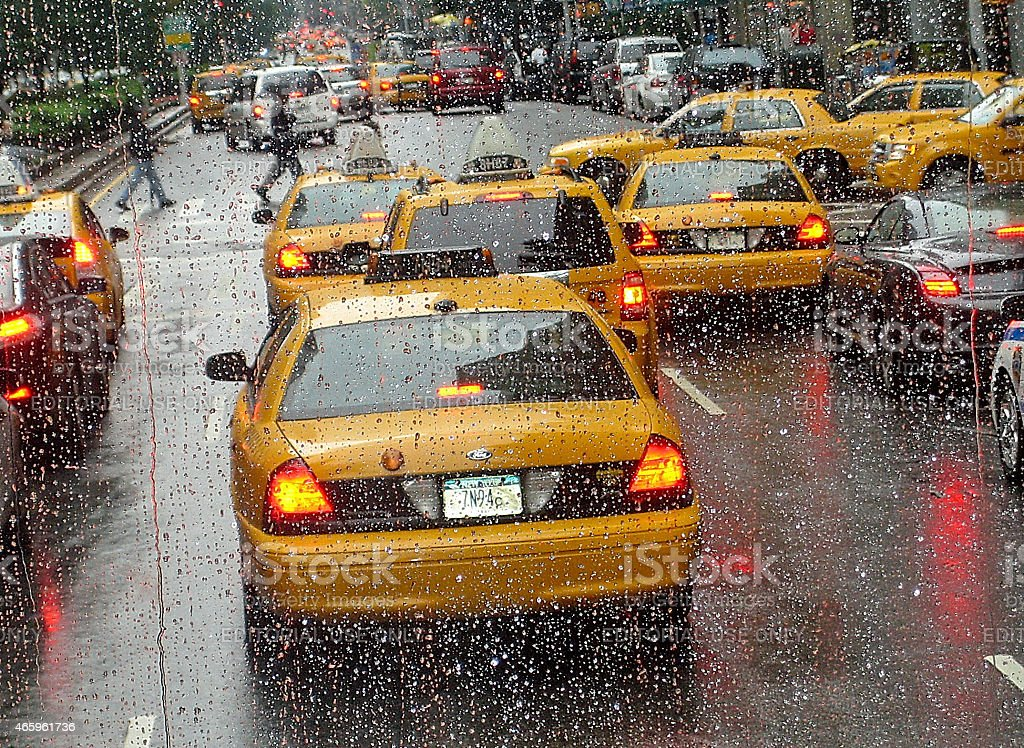 Taxis drive in rain near Times Square, New York, USA stock photo