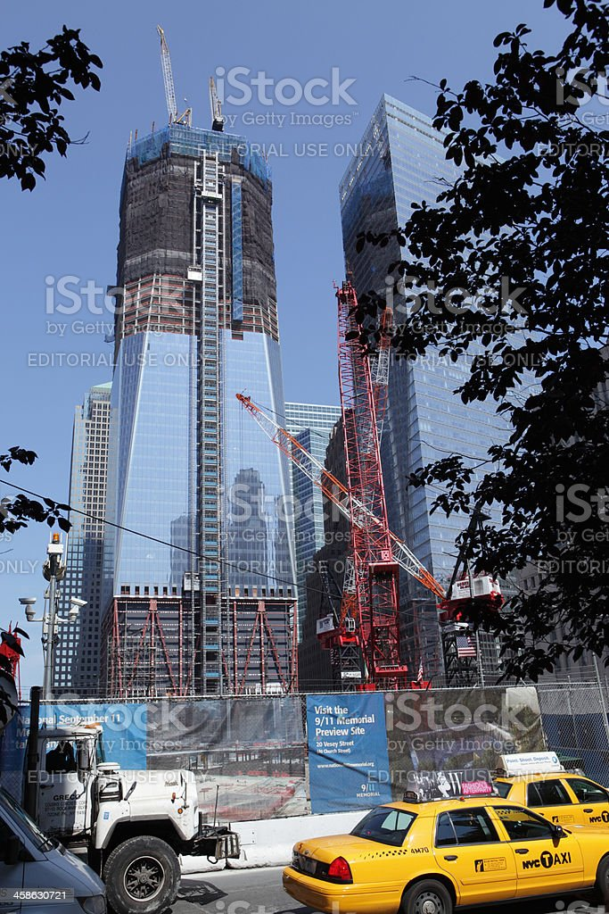 Taxis drive past the World Trade Center construction site NYC stock photo