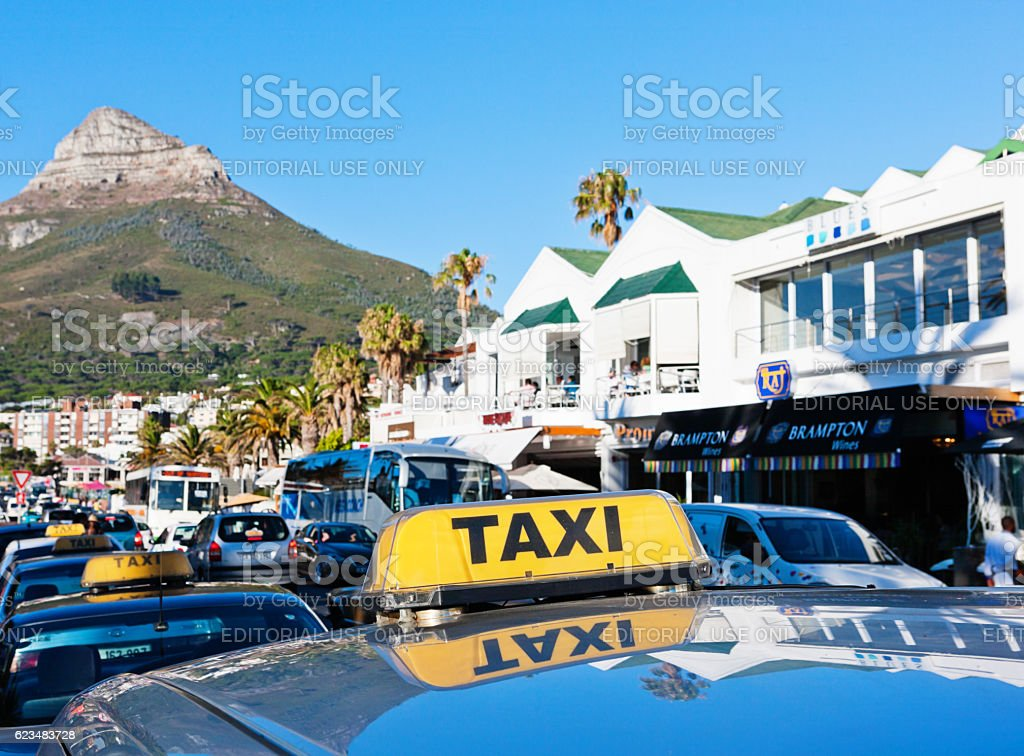 Taxis in busy vacation destination Camps Bay, Cape Town stock photo