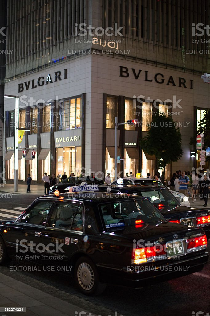 Taxis in front of BVLGARI store in Tokyo stock photo