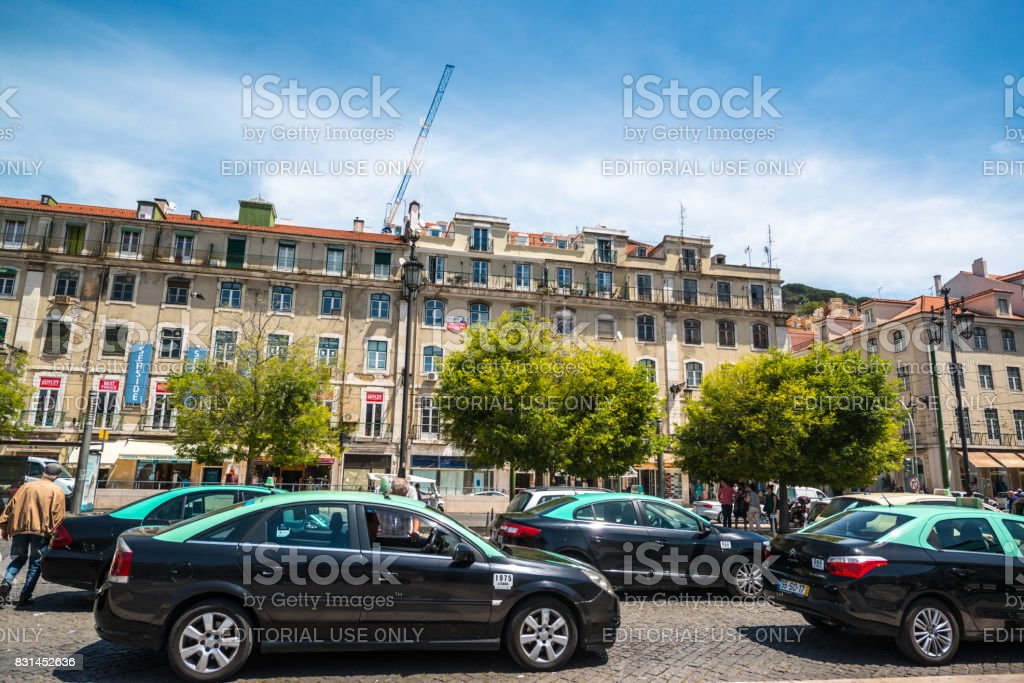 Taxis in traffic in Lisbon city center, Portugal stock photo