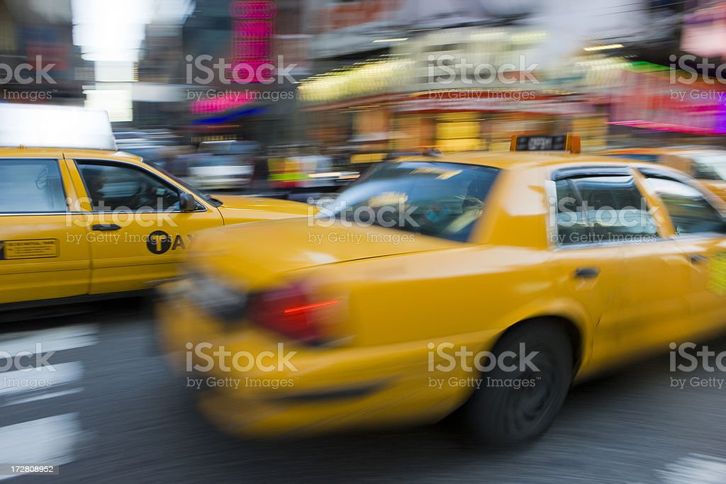 Taxi's Passing royalty-free stock photo