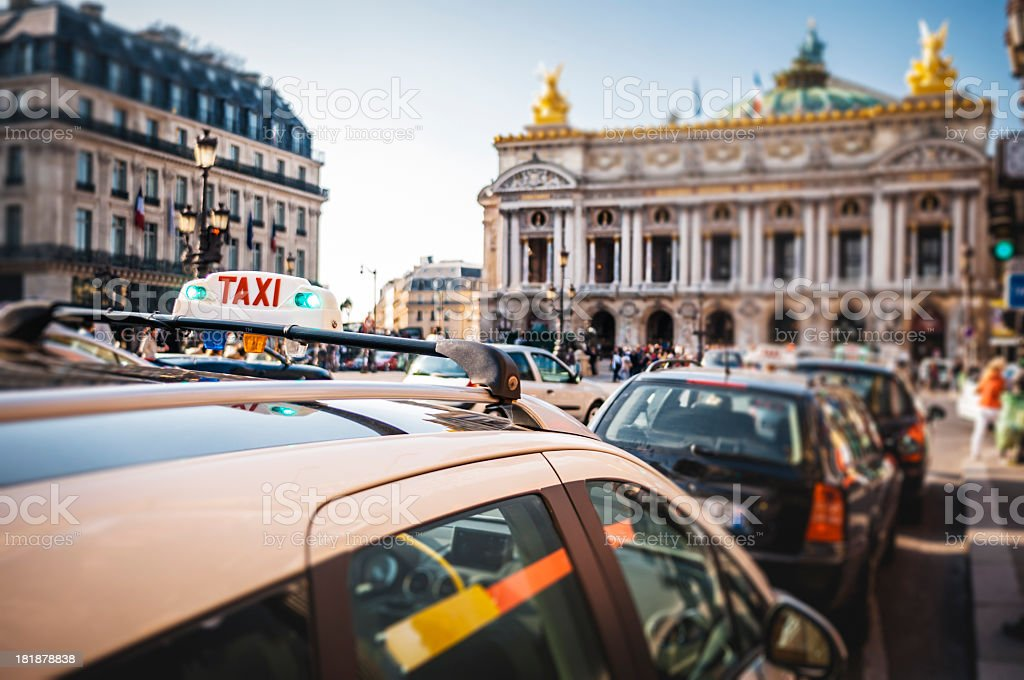 Taxis waiting in front of the Opera in Paris stock photo