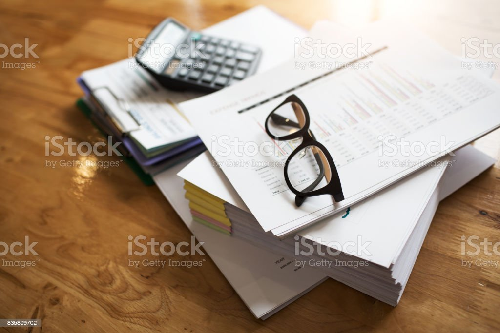 Taxpayer's desk and excise documents to import and export industrial goods for the purpose of maximizing profits for large business organizations. stock photo