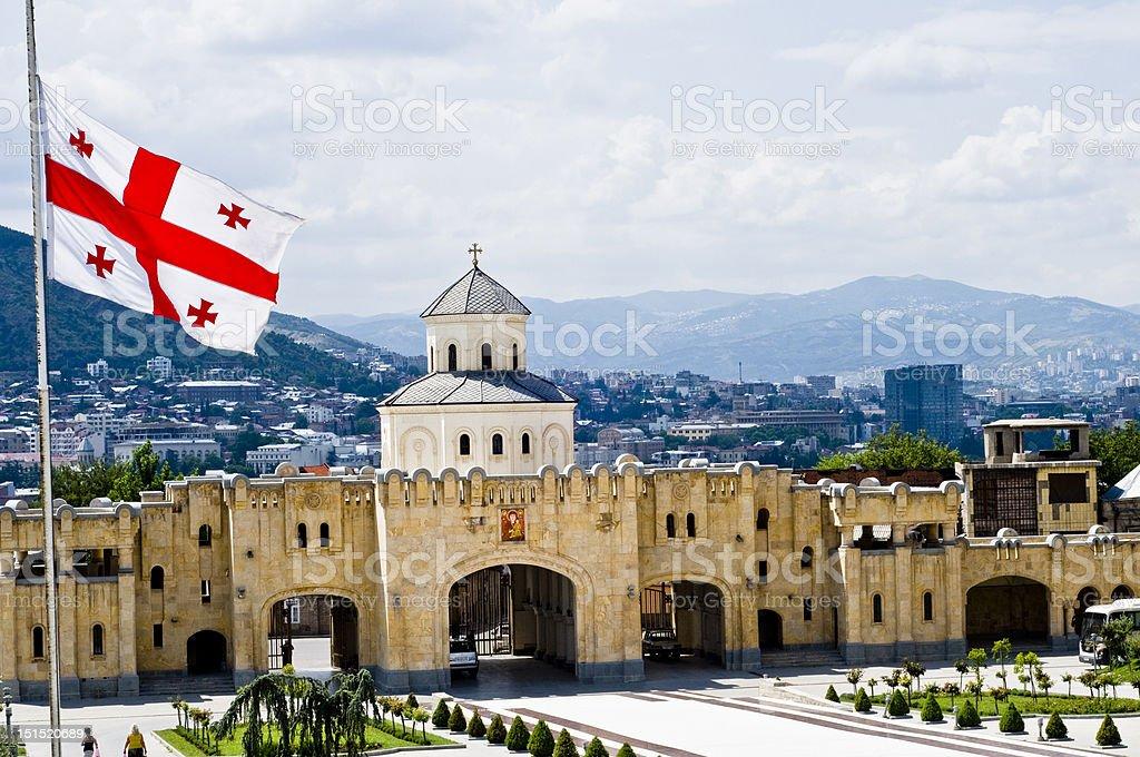Tbilisi panorama with georgian flag stock photo