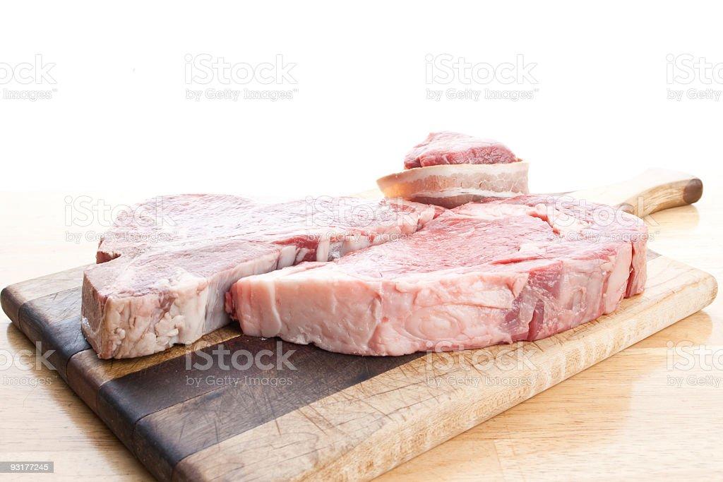 T-Bone and Ribeye on Butchers Board stock photo