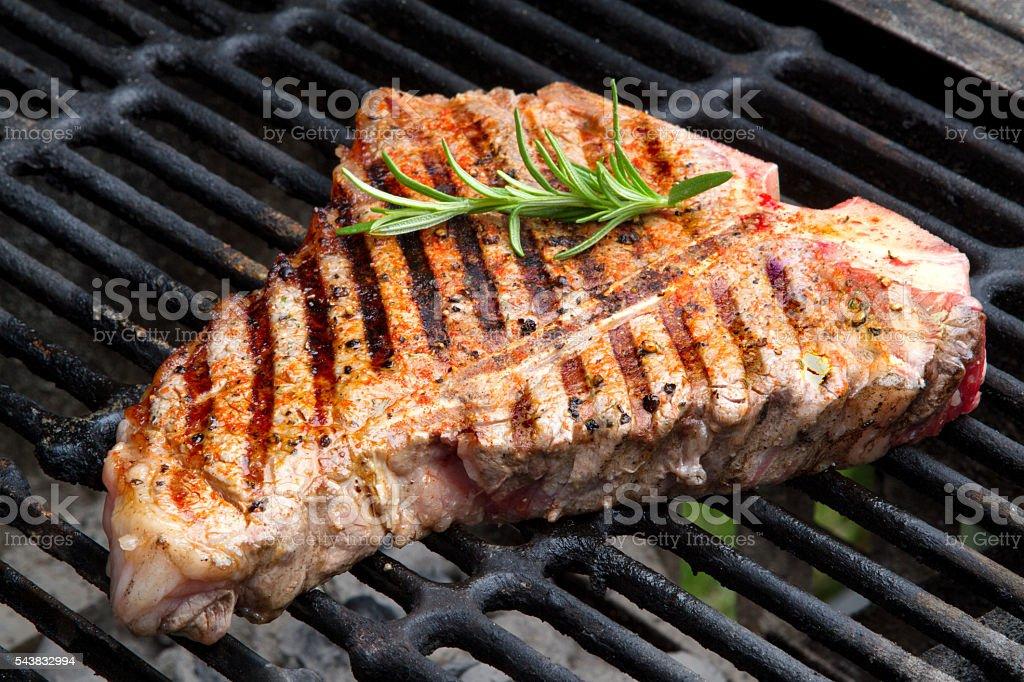 T-Bone Beef Steak on a Grill stock photo