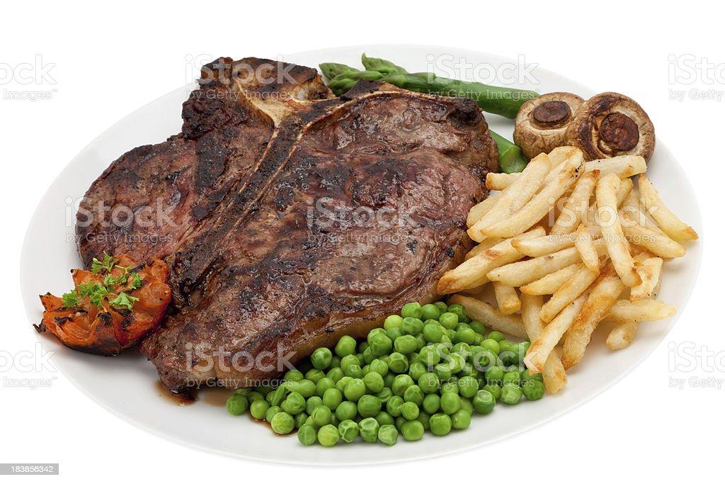 T-Bone or Porterhouse steak dinner stock photo