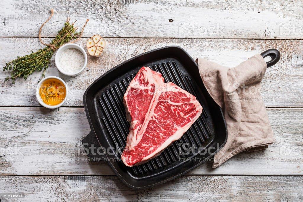T-bone Steak on frying grill pan stock photo