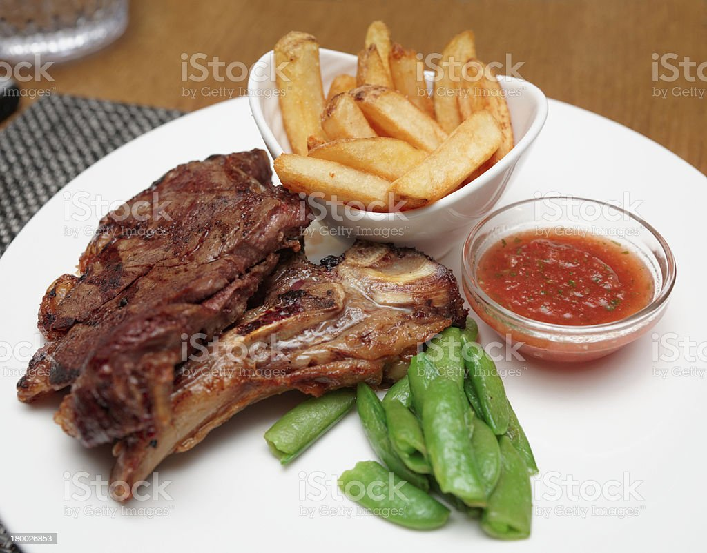T-bone steak with french fries royalty-free stock photo
