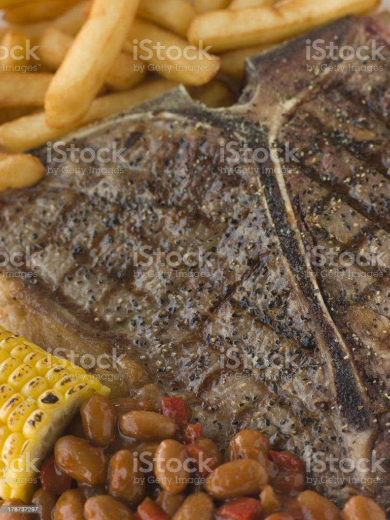 T-Bone Steak with Fries Corn and Beans royalty-free stock photo