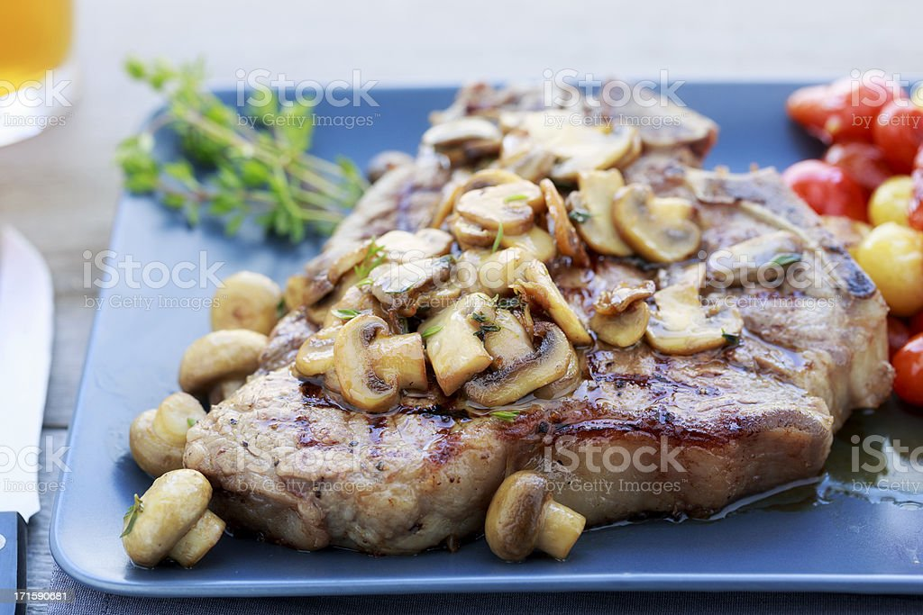 T-Bone Steak with Mushrooms royalty-free stock photo