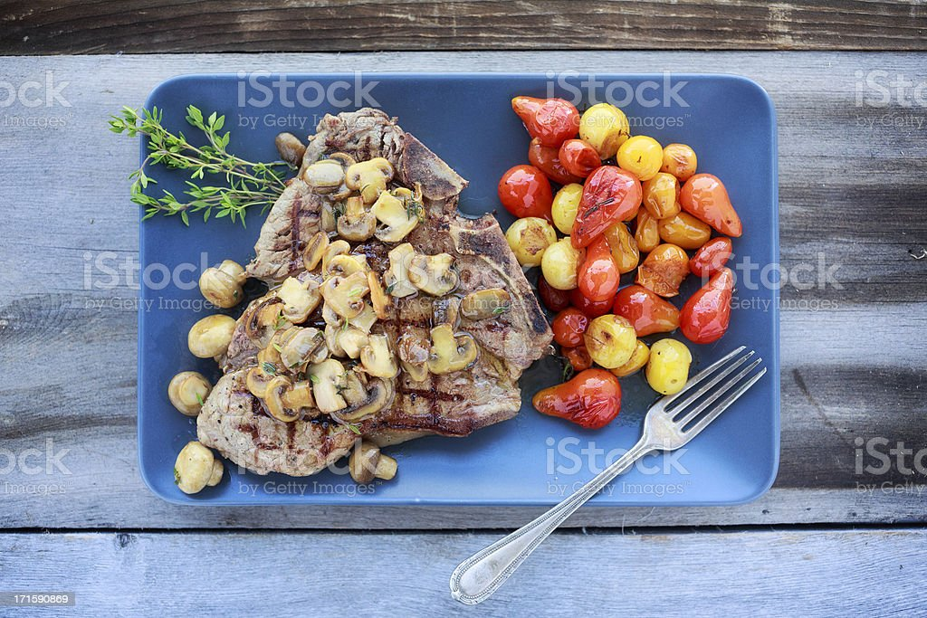T-Bone Steak with Mushrooms stock photo