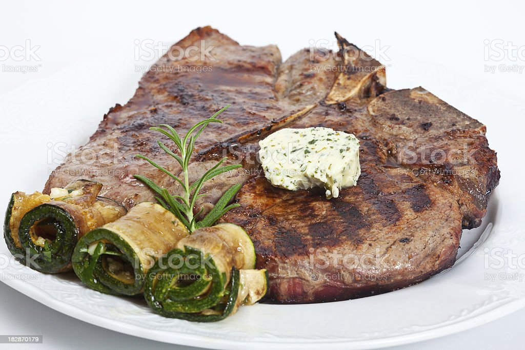 T-bone steak with zucchini stock photo