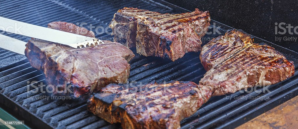 T-bone Steaks  on the BBQ Grill royalty-free stock photo