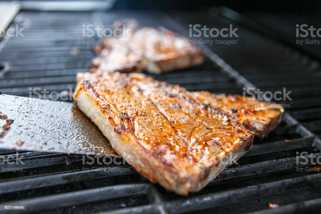T-bones on the grill stock photo