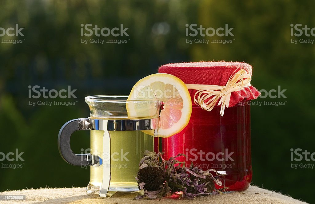 Tea and a jar of jam royalty-free stock photo