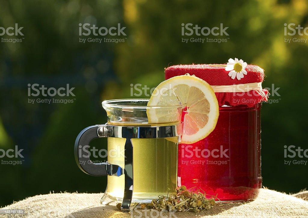Tea and a jar of jam royalty-free stock photo