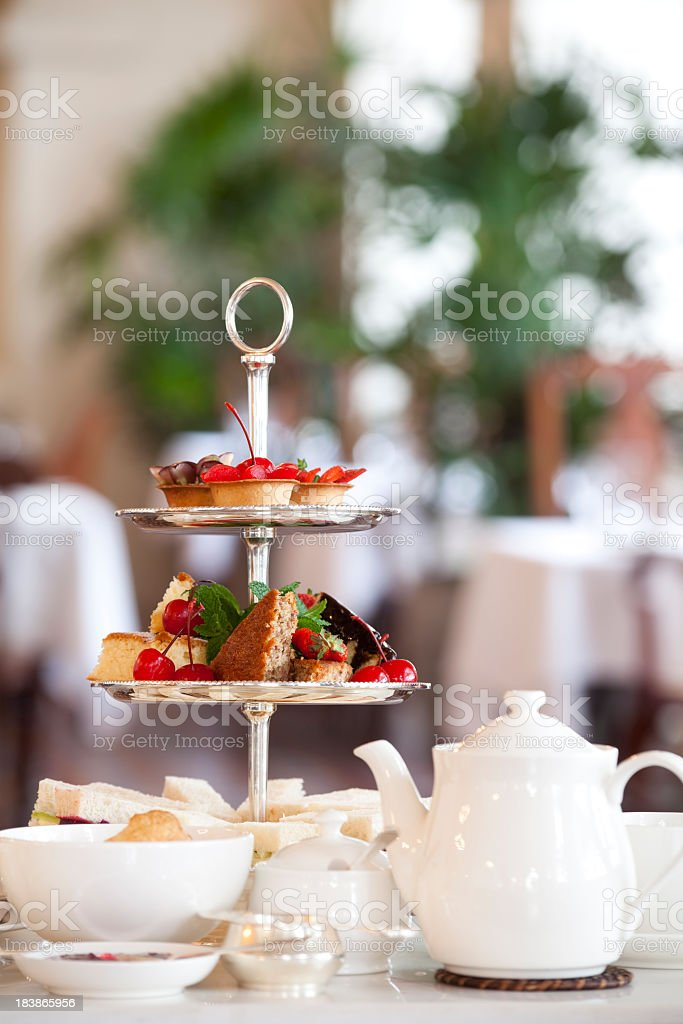 Tea and bread set at a table in a restaurant stock photo