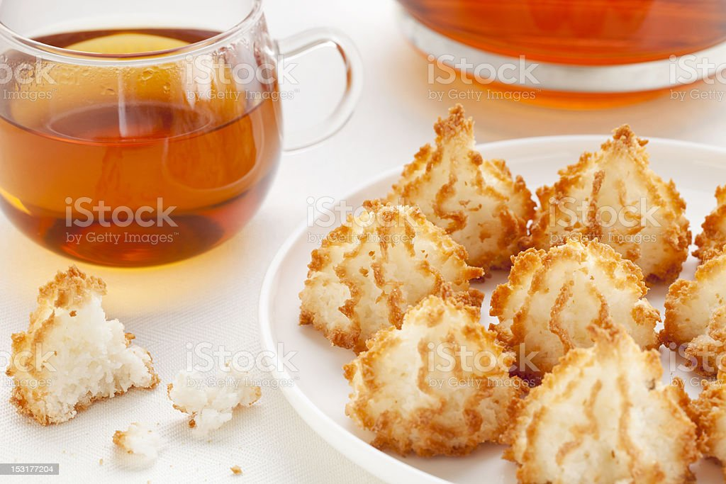 tea and coconut macaroons stock photo