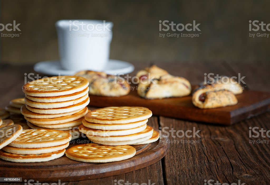 tea and cookies on a rustic table stock photo